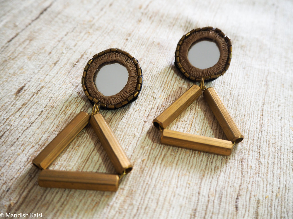 Zaha stud earrings  Embroidered mirrors with brass beads and brass tubes.
