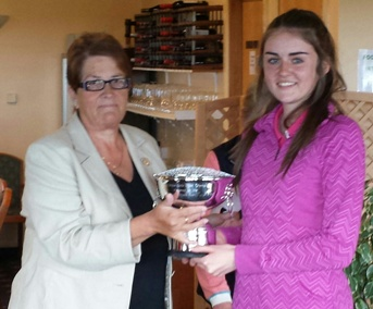 Ella Griffiths receiving the 'Rees Evans Trophy' - Mid Wales Girls Open Champion 2015 from Kath Furneaux, Ladies Captain Aberdovey Golf Club.