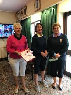 Jenny Lewis of Brecon (R), Margaret Bowen, MWCGA Vice-Captain (L) and Gail Beaurain, St. Idloes Club Chairman (M)