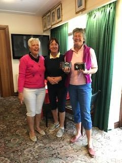 Sally Wilkinson of Aberdovey (R), Margaret Bowen, MWCGA Vice-Captain (L) and Gail Beaurain, St. Idloes Club Chairman (M)