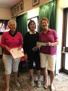 Angela Benbow of St Idloes (R), Margaret Bowen, MWCGA Vice-Captain (L) and Gail Beaurain, St. Idloes Club Chairman (M)