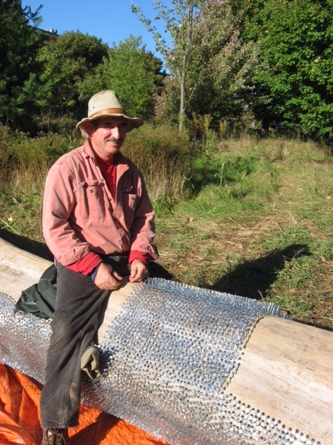 Artist, Paul Griffin halfway through 8 day nailing marathon of 63,000 galvanized electroplated roofing nails.