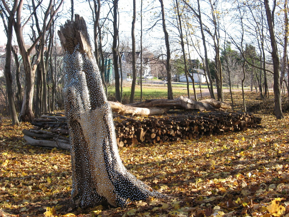 Deadfall Sleep and Hunter,  2008, maple stump, electro galvanized nails.