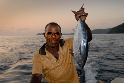 Boatman with freshly caught Tuna