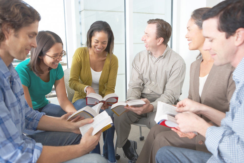 Bible-group-reading-together-in-a-close-circle-1664x2496.jpeg