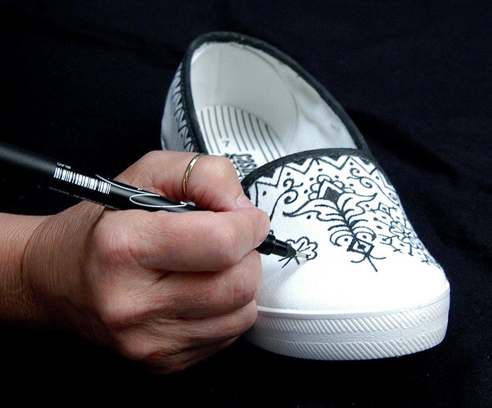 Tee Juice on canvas shoe