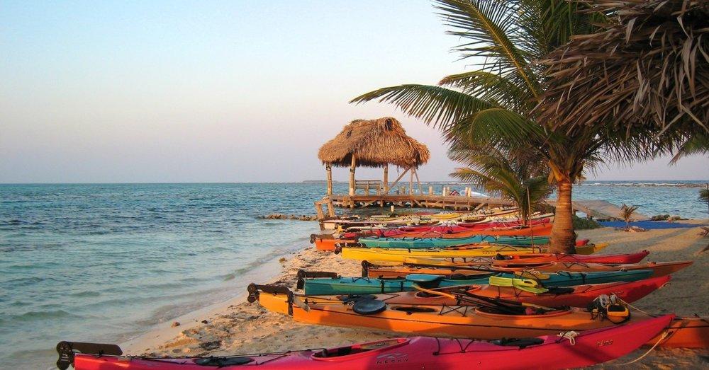 kayaks-on-a-beach-in-belize-1450107167-plDR-facebook@2x.jpg
