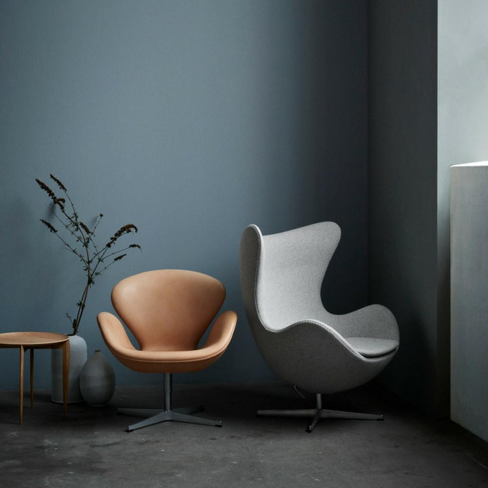 fritz-hansen-egg-and-swan-chairs-in-room-with-tray-table-arne-jacobsen_1024x1024.jpg
