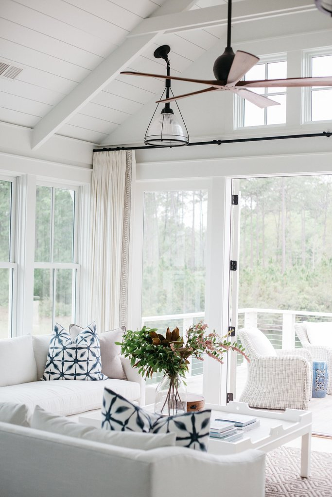 Charming white coastal cottage with board and batten exterior and classic modern farmhouse style interiors by Lisa Furey. Come take the tour in Coastal Cottage Interior Design Inspiration - Part 1 {Get the Look!} with decorating ideas and shopping sources for furniture and decor!