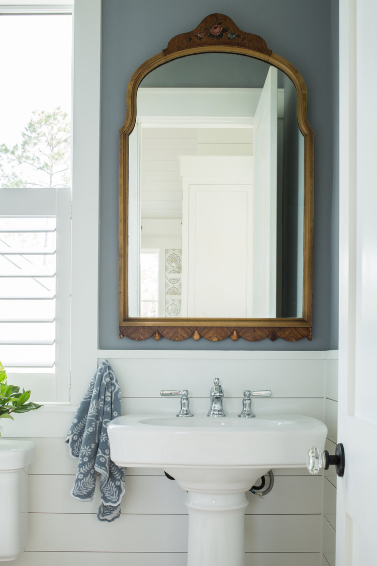 Powder room with blue walls, shiplap, and vintage mirror. Coastal Cottage Interior Design Inspiration - Part 1 {Get the Look!} #powderroom #blueandwhite #shiplap #cottagestyle Coastaldecor