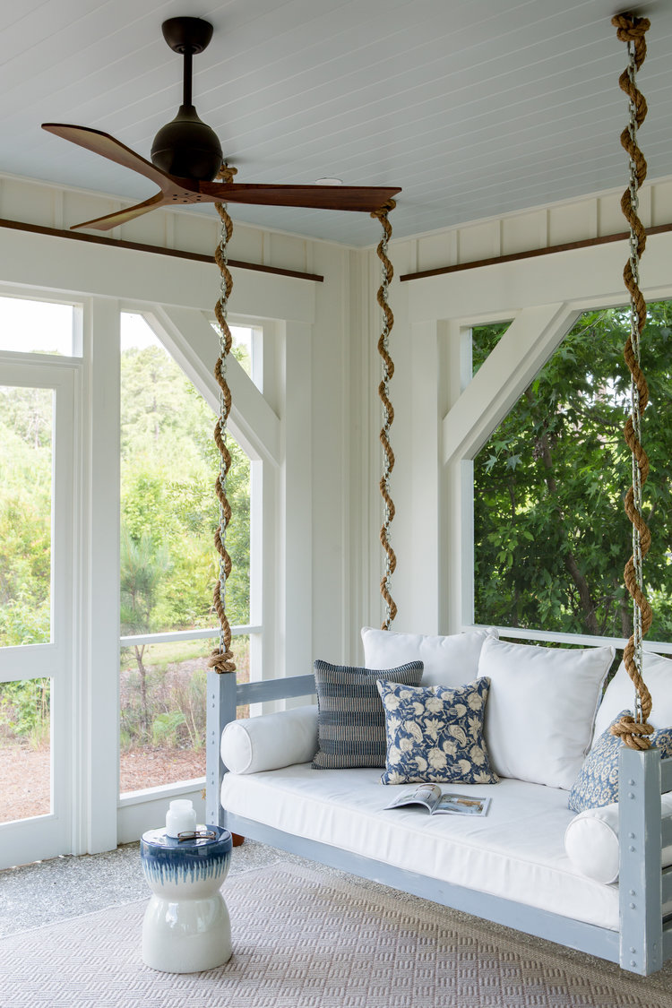 Screen porch with swing bed. Board and batten siding. Coastal Cottage Interior Design Inspiration - Part 1 {Get the Look!} #screenporch #boardandbatten #swing #bedswing