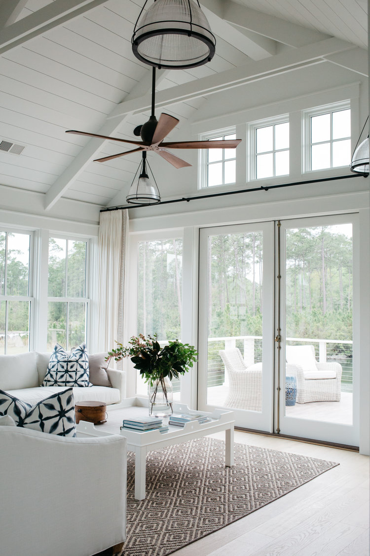 White living room with indigo blue accents. Coastal Cottage Interior Design Inspiration - Part 1 {Get the Look!} #livingroom #cottagestyle #coastaldecor