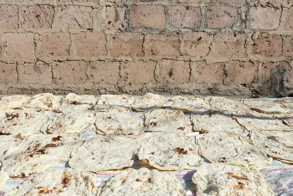 It's traditional to bake lavash in the fall to eat all winter long. At the home we visited in Yeghvard, the floors and roof were lined with lavash. Once dried, it was stacked and stored in a spare bedroom.