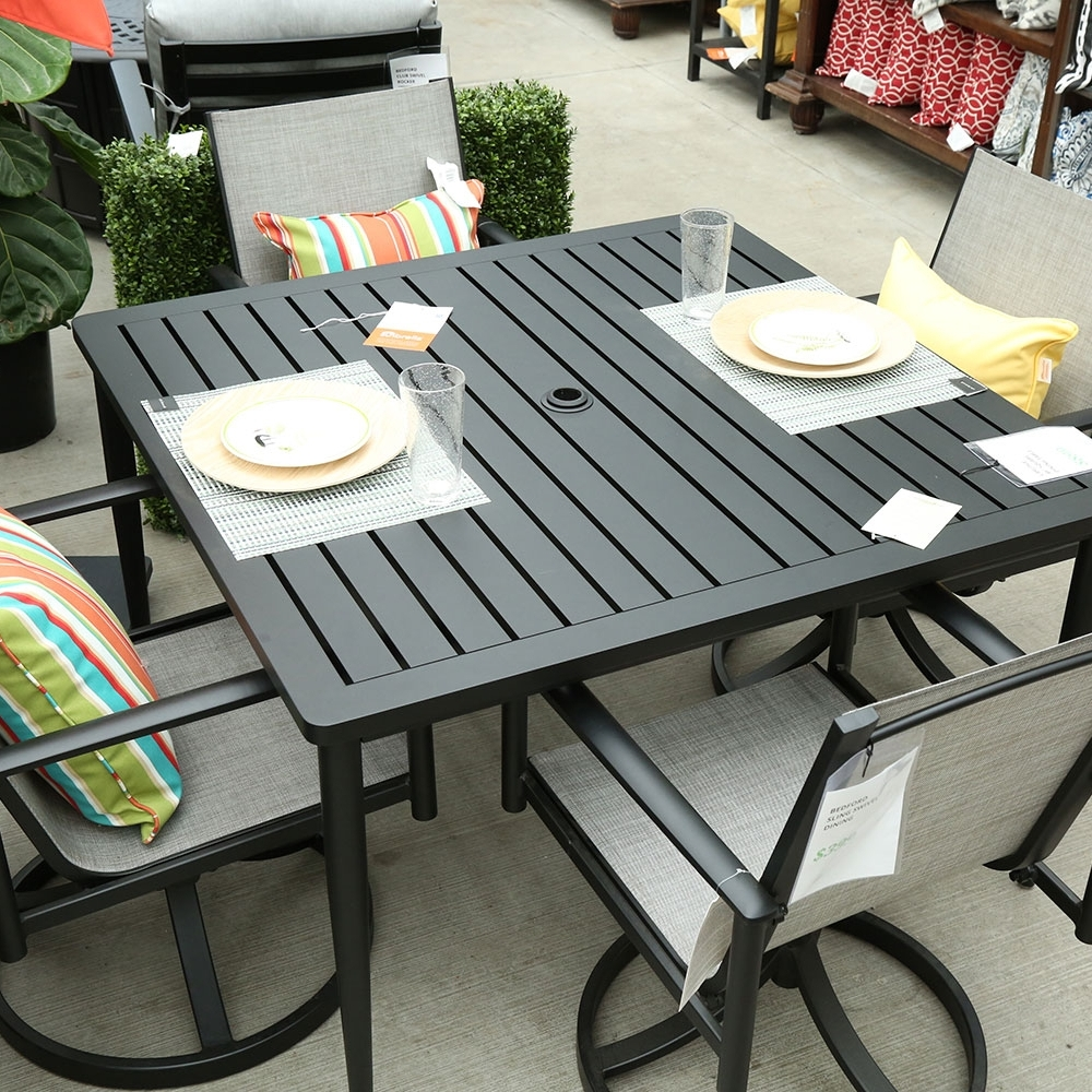 Bedford Dining Sets - This mid-century inspired dining set can fit any style of home. The neutral tones match any color scheme and allow you to accessorize with pops of color. With powder coated aluminum frames and woven all weather sling material this set is built to last.