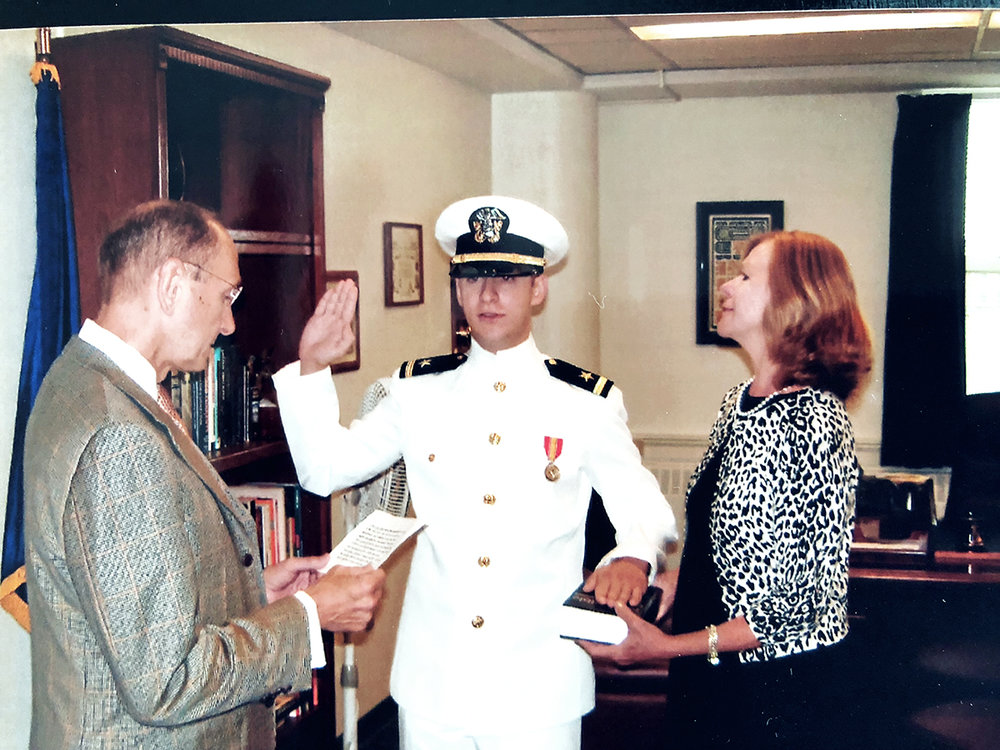 My mother and father reading me my oath of office as an officer in the US Navy in August 2009.