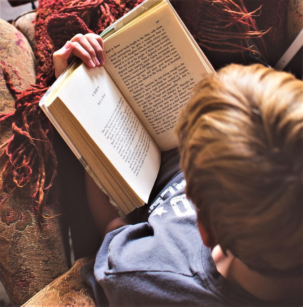blanket-book-boy-79697 pexels.jpg
