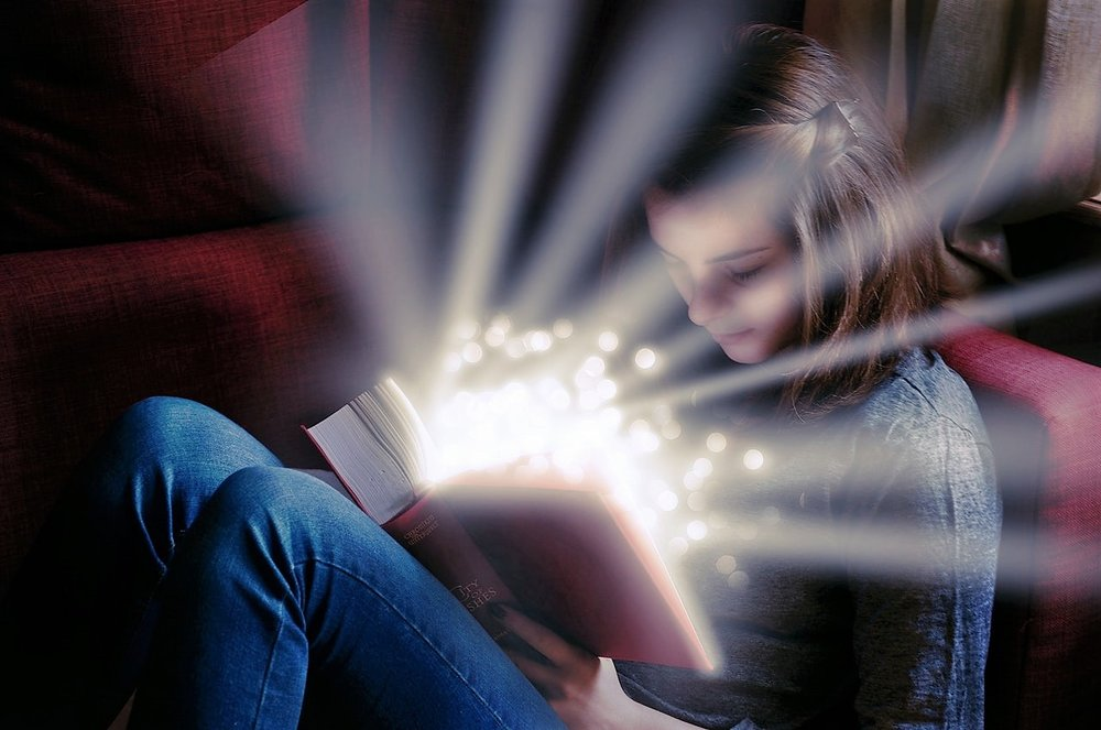 girl with luminous glow book.jpeg