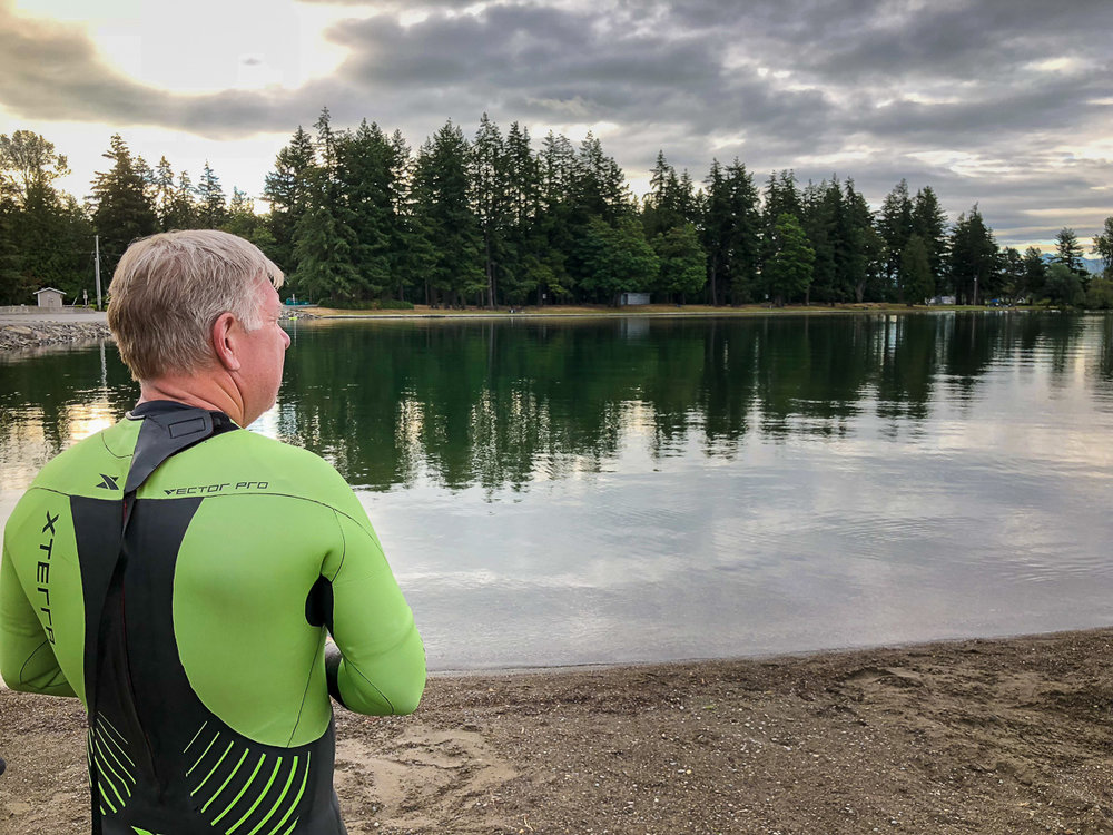 Dave thinking about the cool, 6am waters of Lake Tapps he's going to swim in order to get the shots we need.