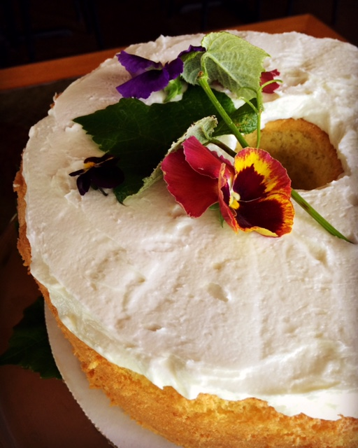 OUR HEAVENLY LEMON CHIFFON CAKE - Ingredients2 cups flour1 1/2 cups sugar1 tablespoon baking powder1 teaspoon salt3/4 cup water7 egg yolks1/2 cup vegetable oilGrated zest of 2 lemons2 teaspoons vanilla8 egg whites1/2 teaspoon cream of tartar1 1/2 cups confectioners' sugar2 tablespoons plus 1 teaspoon fresh lemon juice2 tablespoons melted butter1 teaspoon grated lemon zest