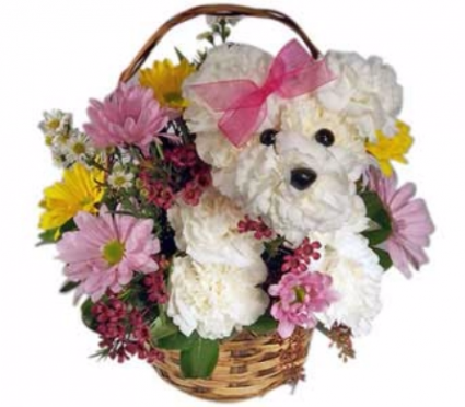 """Gift Idea #7:  Flowers are the go to present for almost any occasion! For this special day how about Glamming up your flower arrangement with your Moms favorite animal or something you think will wow her. The florist are getting so creative these day. I do recommend specialty flowers from this  florist. Surprise mom with a beautiful arrangement. In the note write:  """"A Beautiful arrangement for a Beautiful Mother!"""""""