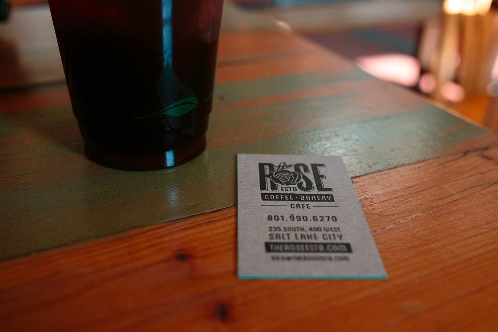 Rose Establishment information card on table