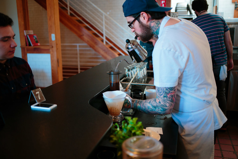 Rose Establishment barista brewing coffee with Aeropress