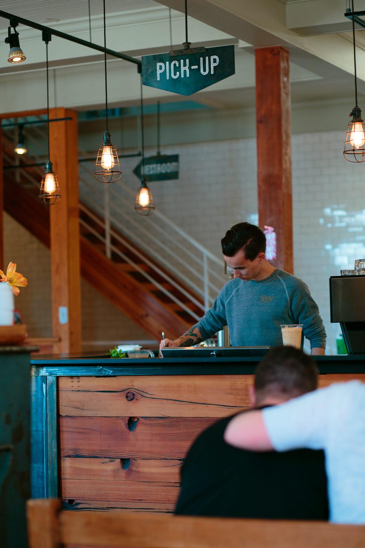 Barista making coffee at rose establishment