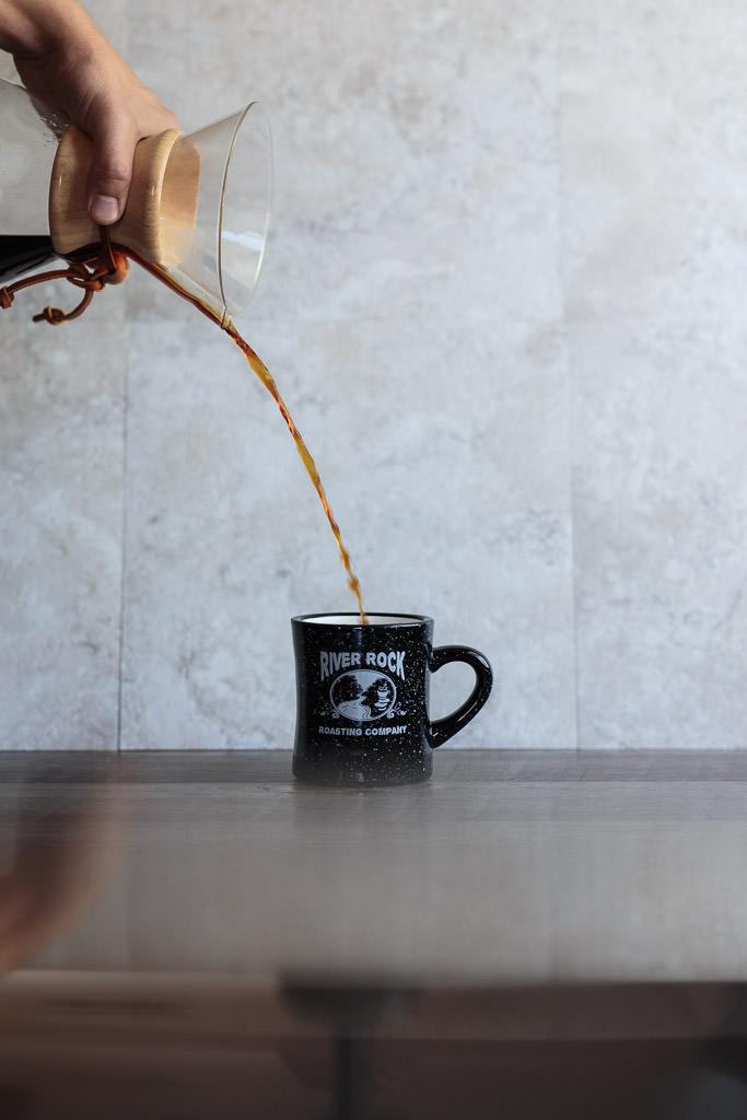Pour coffee into a warmed coffee mug