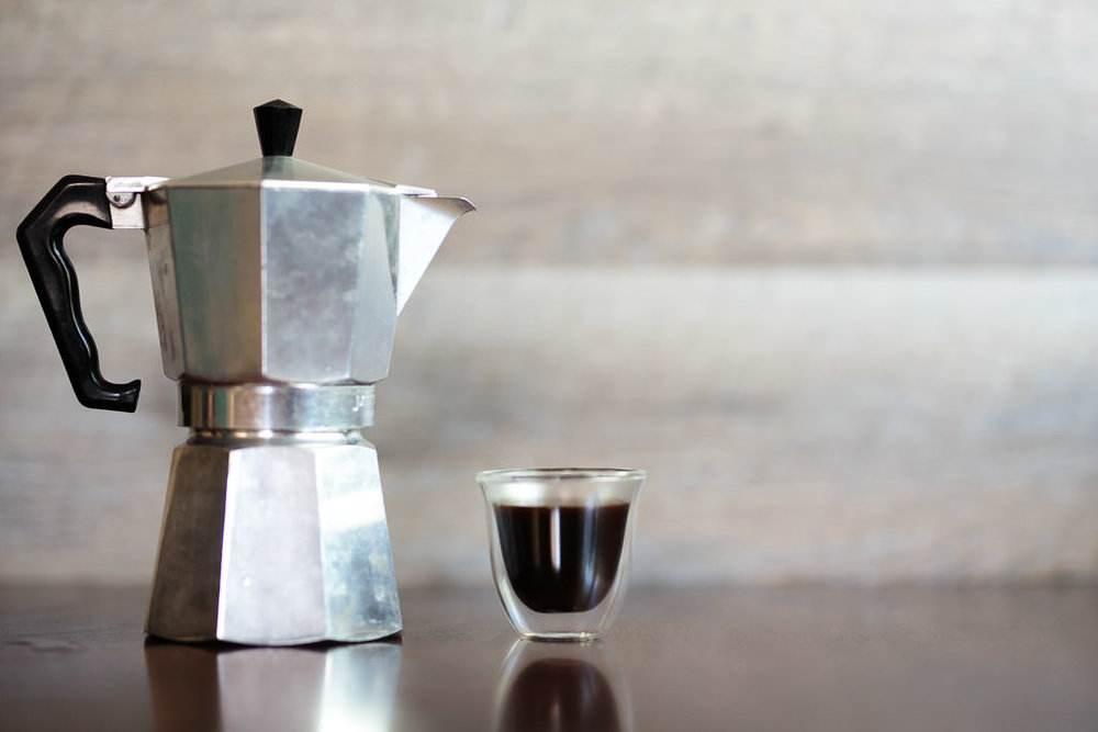 Moka pot espresso in demitasse cup