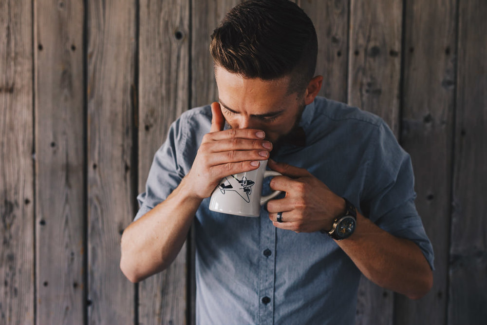 Barista smelling coffee for a taste test