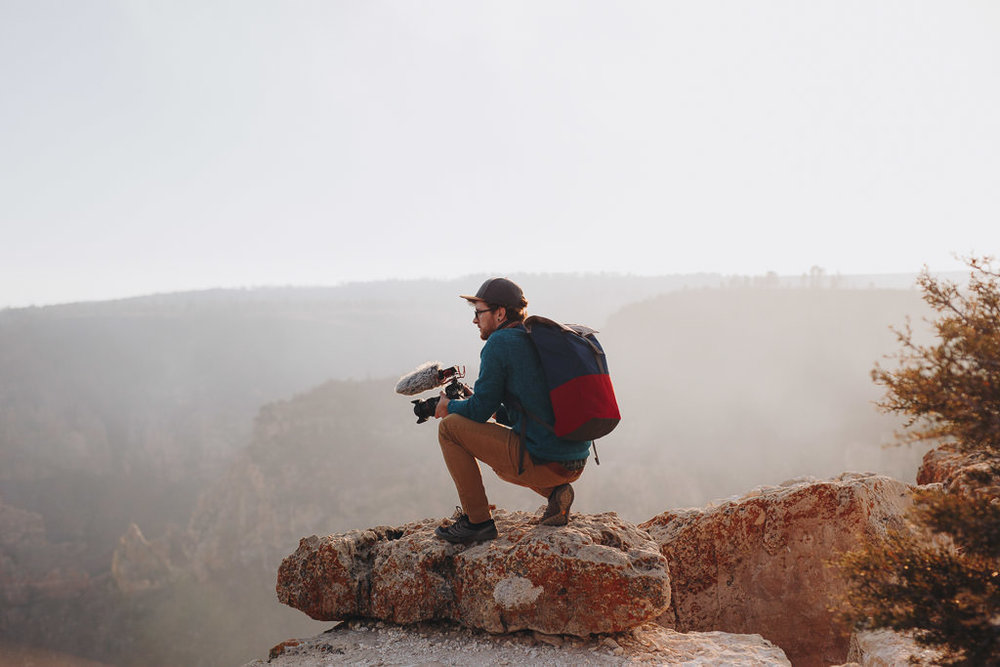 Videographer wearing cotopaxi backpack at Grand Canyon