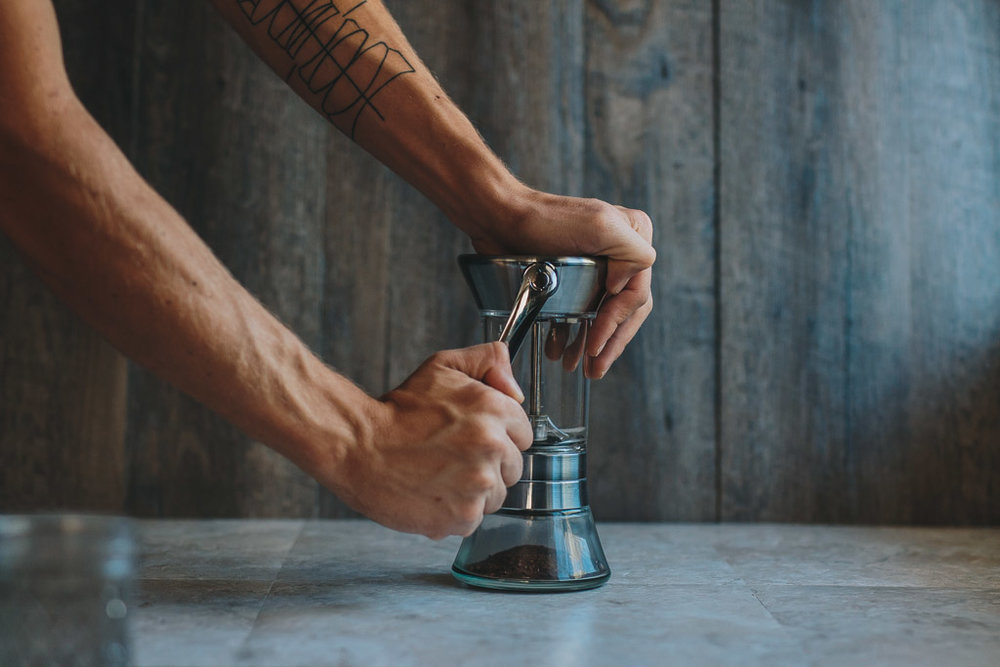 Grinding coffee with Handground precision hand grinder