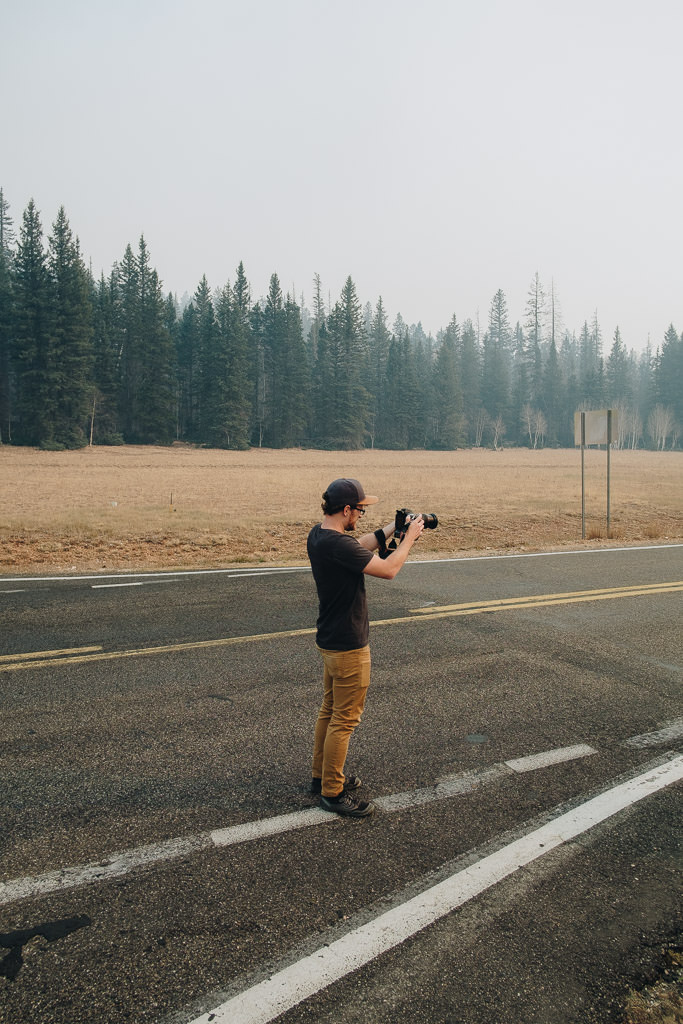 Photographer taking pictures in the road