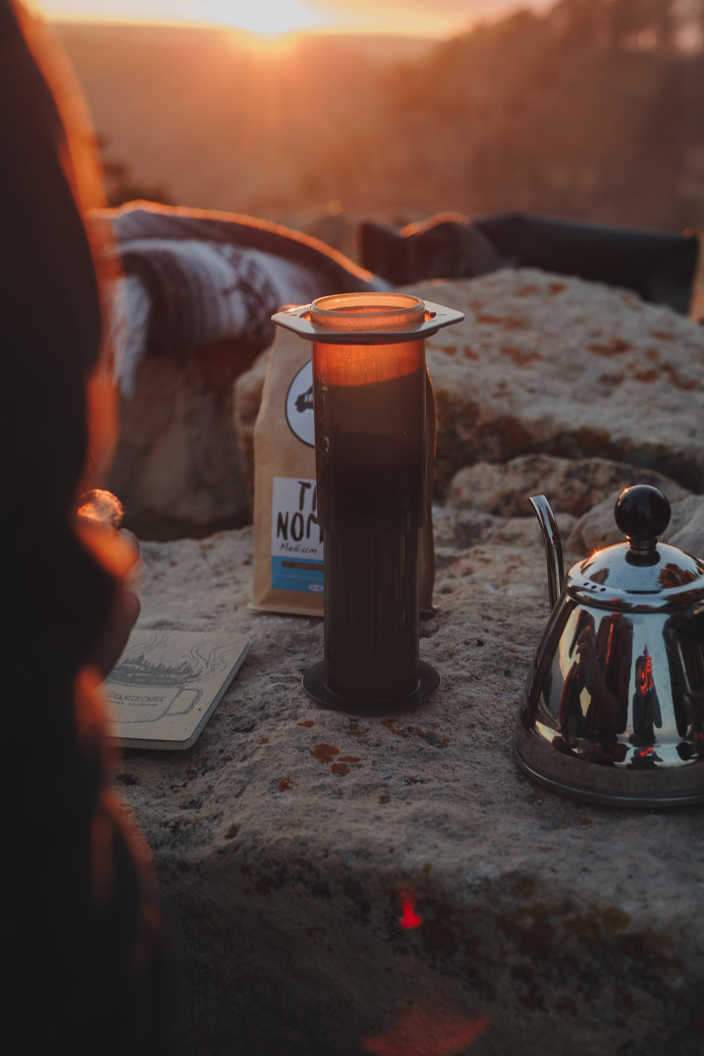 Upside down Aeropress being brewed outdoors
