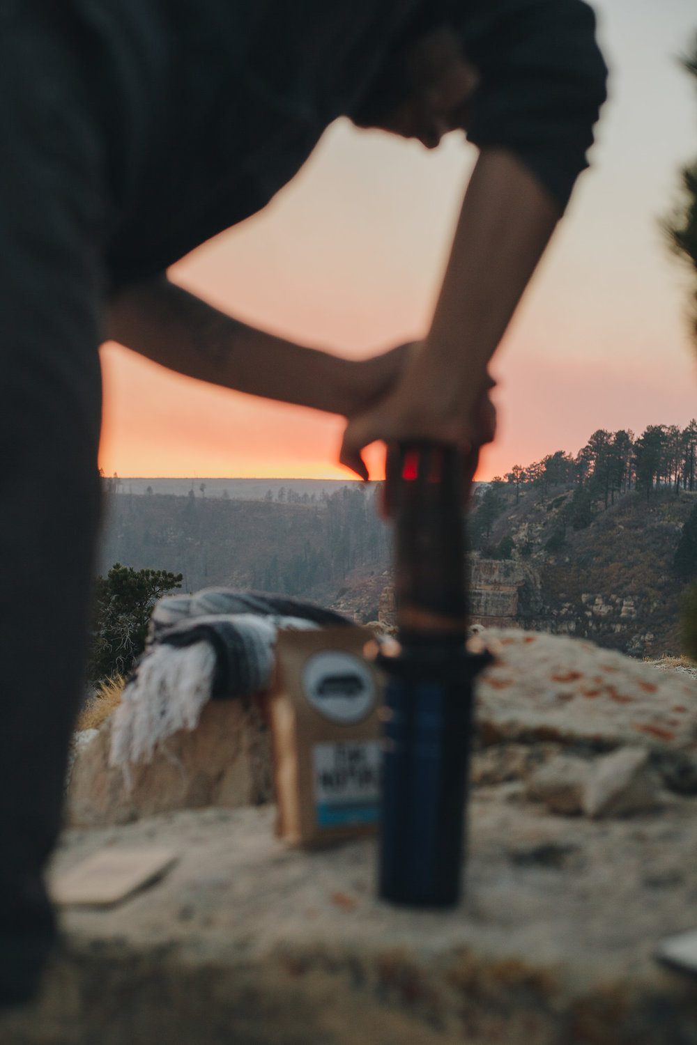 Pressing Aeropress with Grand Canyon sunset view