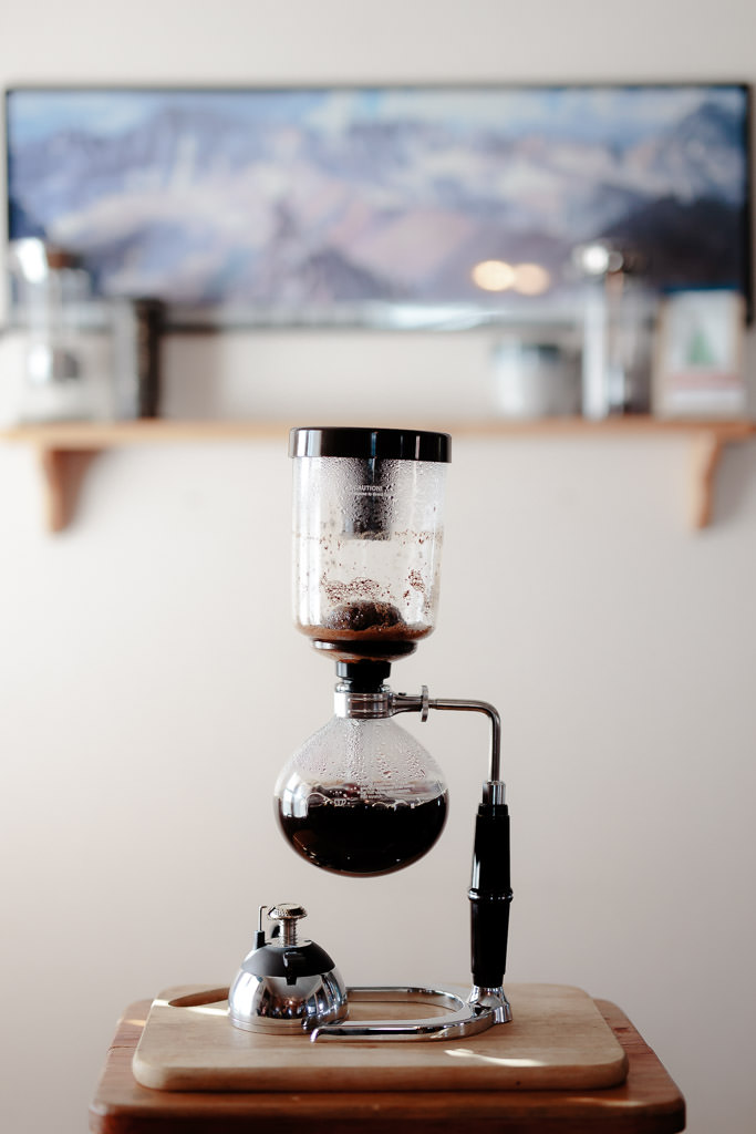 Allow the coffee to draw into the lower vessel