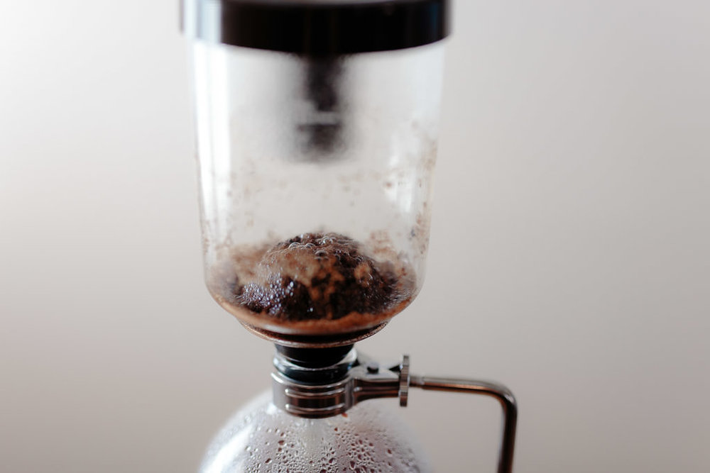 Mound of grounds formed after brewing with the siphon