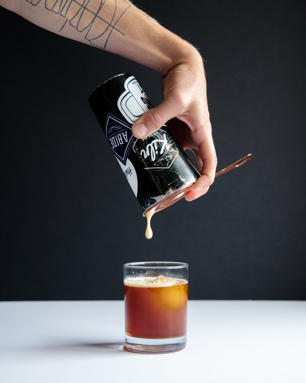 Aerate by shaking cold brew with ice