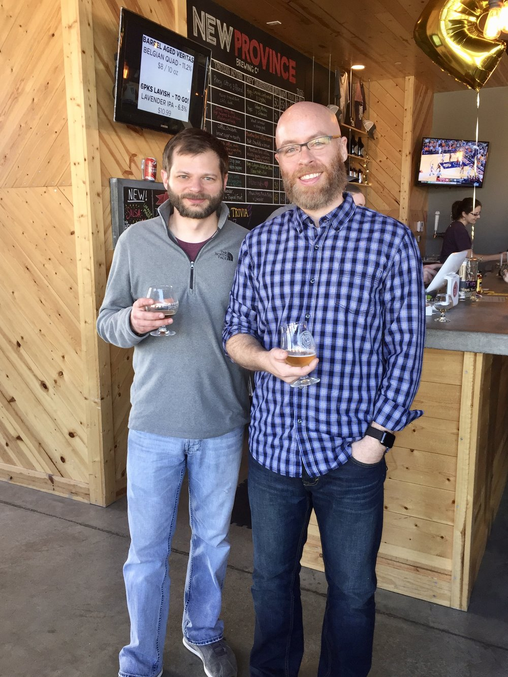 "That's New Province head brewer Kort Castleberry on the left and me on the right. I call this picture, ""Battle of the Beards."" I have since shaved, Kort has not. Has anyone ever seen him without a beard? What's he hiding under there?"
