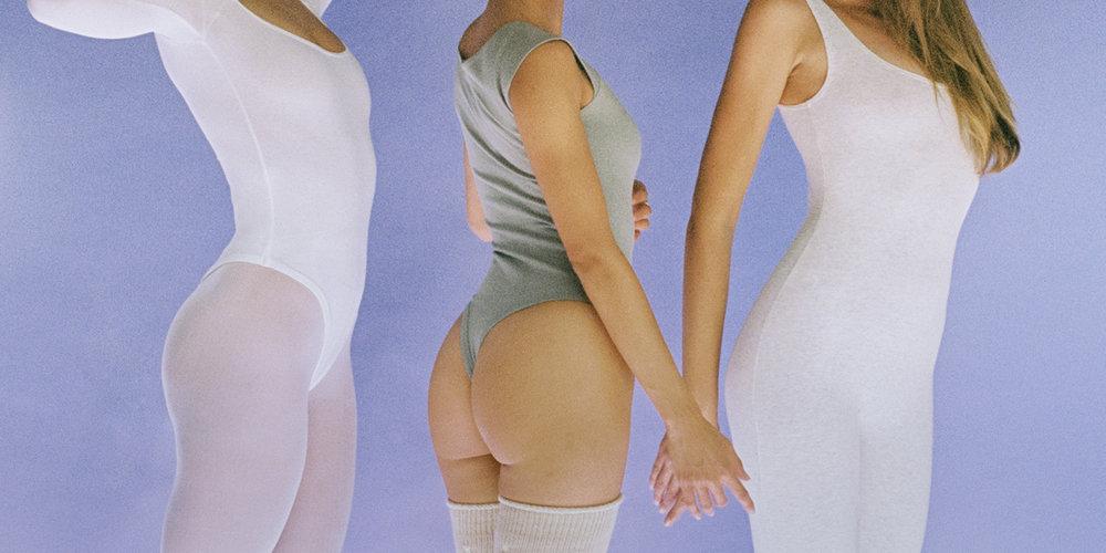 Ella, Rachel and Laura in bodysuits and unitards.