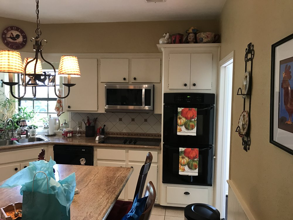 To Buy New or Remodel Old - Our wonderful clients were trying to decide between buying a new home, or remodeling their current home. Between not wanting to move and not wanting a property tax increase, they decided to remodel! Lucky for us, we were there waiting and ready. With kids grown and out of the house, they were ready to make their home their own.This remodel total included a full kitchen and half bath remodel, removal of several load bearing walls, all new flooring and paint downstairs. The home transformed from a typical 70's look, to a new contemporary residence full of modern touches.  See Below for the Transformation!