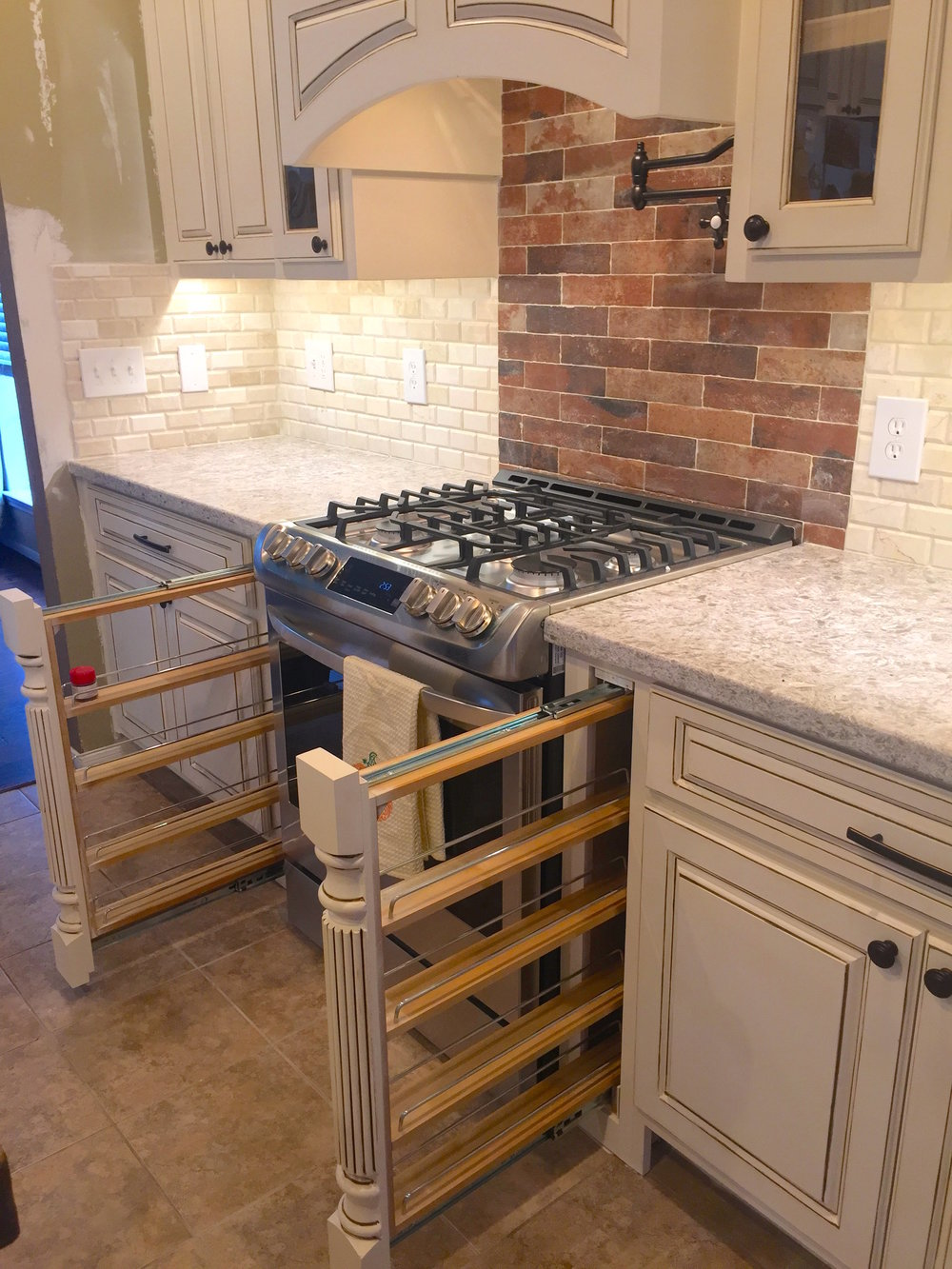 Young Family, New Kitchen - Our client in Imperial Oaks in Spring, TX wanted to remodel to old and dysfunctional kitchen to be more practical, stylish, and smart.In this kitchen we built custom cabinetry, backsplash, spice pull outs, and a hand applied glaring effect.See more below!