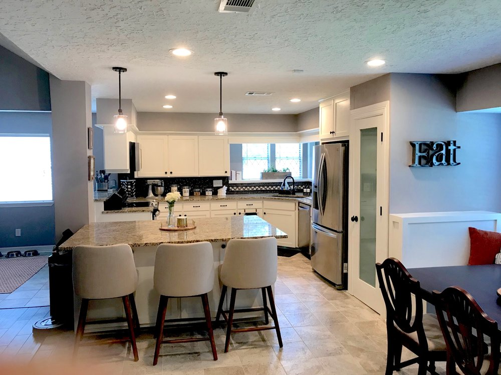 Open Concept - Our client in Spring, TX wanted to remodel their kitchen to feel more open and create one large living space.To accomplish this, we installed several load bearing beams, a new island and bend seating, pantry, and flooring.See more below!