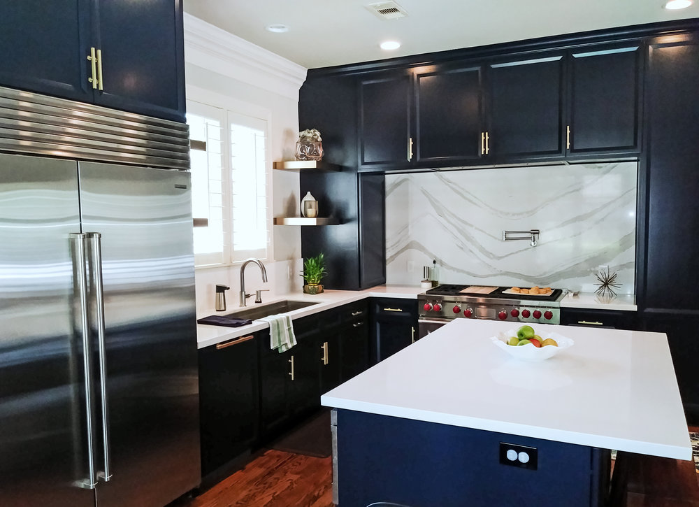 Something Modern - Sometimes, a good space isn't good enough. Our client in Sterling Ridge in The Woodlands did not have a terribly outdated kitchen, but just wanted something more. Something modern, tasteful, elegant, and full of usability.This beautiful kitchen remodel incorporated sleek blue cabinets, complimented by a gorgeous white Quartz with grey veining. Large pantry cabinets were used, along with high end appliances.See below for the Transformation!