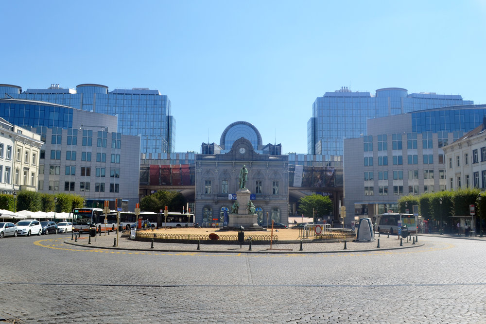 Luxembourg Square - The facade of the Station Europe building in the centre is the old entrance to the Brussels-Luxembourg station. The station used to be at road level but has since been covered over and moved completely underground to make way for the public agora and esplanade