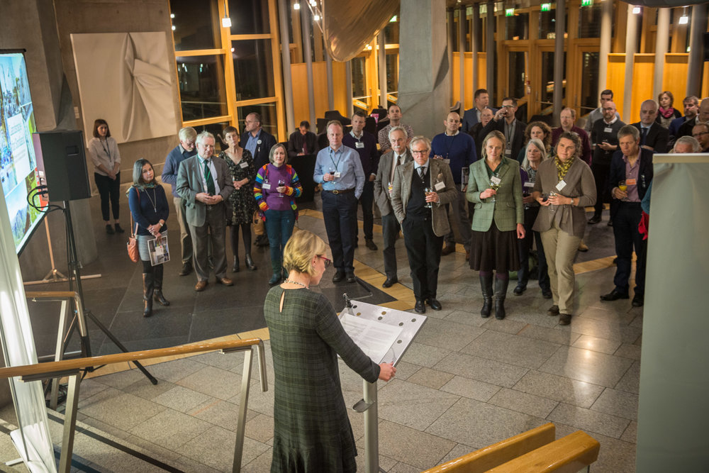 A speech being given at the bottom of the grand stairs in the Garden Lobby which lead to the Debating Chamber (Source: Scottish Parliament)