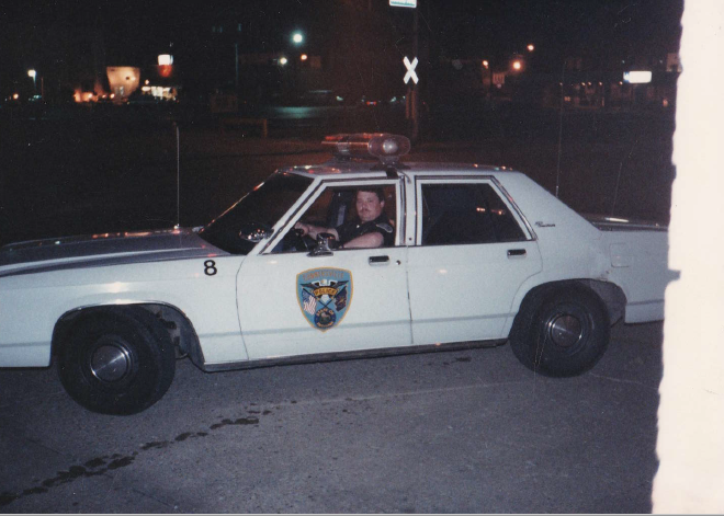 Jeff in his police car, 1988