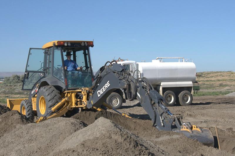 Backhoe digging septic system .jpg