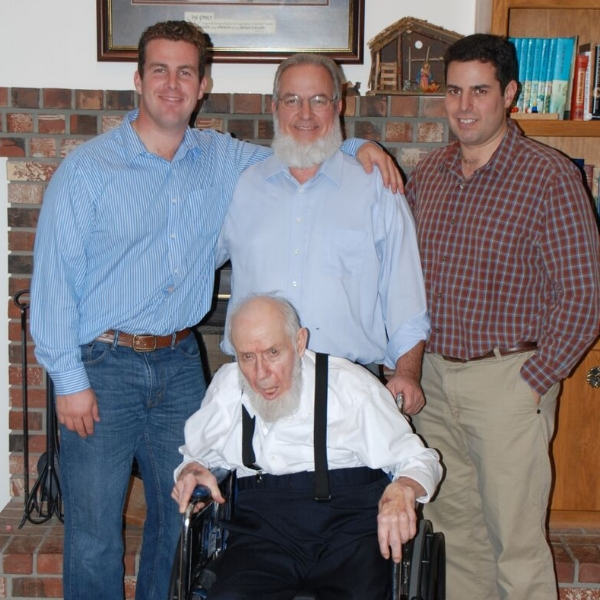 """Jake Wray, Everett Wray and Curtis Wray standing """"Grandpa"""" sitting."""