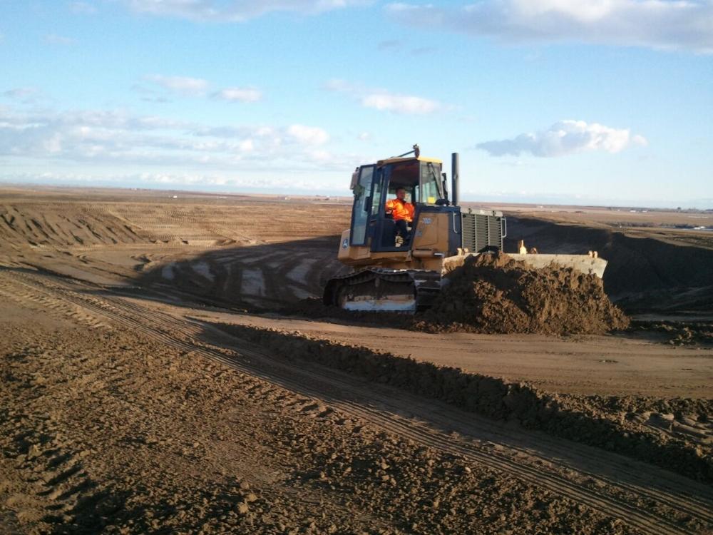 dozer digging irrigation ponds.jpeg